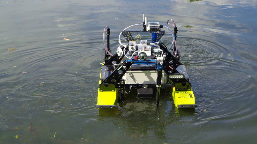 An unmanned surface vehicle (USV) is shown in a lake.